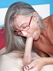 Grey haired mature woman gives a younger man a tugjob he wont soon forget