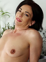 Experienced brunette lady Zoe Gyro stripping off dress and underwear