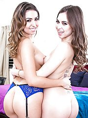 Stocking and garter adorned lesbians Melissa Moore and Riley Reid posing