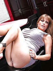 Clothed mature woman Darla Crane unleashes her huge hooters