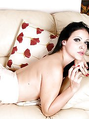 Brunette solo model models topless in stockings while having a smoke