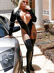 Chesty blonde lady poses topless outdoors in over the knee boots for smoke