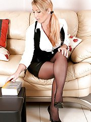 Mature European woman removes nylon clad feet from high heels