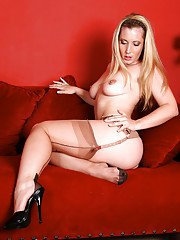 Over 30 MILF pinches topless nipples while posing in nylons and heels