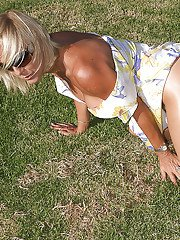 Older blonde broad in sunglasses and pantyhose masturbating outdoors
