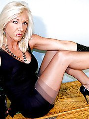Aged blonde Amazing Astrid posing for naughty photos in nylons and garters