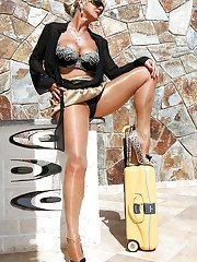 Experienced blonde lady Amazing Astrid modeling non nude outdoors