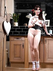 Mature MILF Saffy Mckenna posing in pigtails and nylons in kitchen