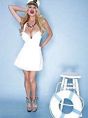 Buxom blonde Kelly Madison lets her huge knockers free from sailor uniform