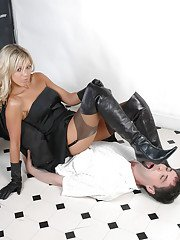 Blonde femdom model Belle smothering submissive man with leather gloves