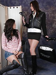 Lesbians in leather boots undress each other after catfight
