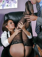 Buxom Latina office worker Eva Angelina spreads stocking clad legs for sex