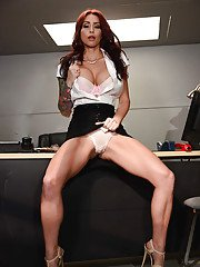 Chesty office worker Monique Alexander flashing upskirt panties at work