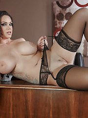 Chesty office worker Alison Tyler showing off juicy butt on desk