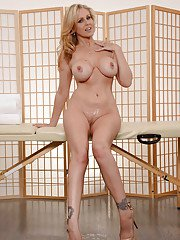 Blonde MILF Julia Ann stripping off denim jeans for nude photo spread
