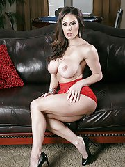 Big bottomed MILF Kendra Lust removes red dress for nude photos
