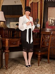 Brunette mom Roxanne Cox modelling fully clothed in skirt and stockings