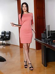 Leggy brunette Kitana Lure modelling fully clothed in dress and heels