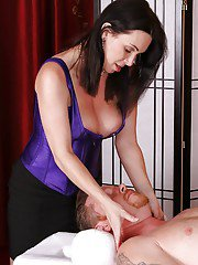 Brunette masseuse RayVeness lets her nice melons loose while giving massage