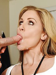 Blonde cougar Julia Ann giving younger man a blowjob and swallowing jism