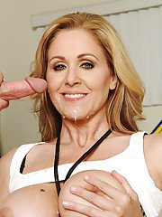Buxom blonde cougar Julia Ann receiving cunt lapping from younger man