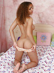 Latina babe Donna E playing with all natural tits in her bedroom