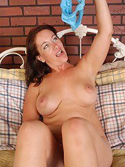 Aged MILF Sandy playing with large knockers and licking own panties