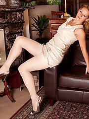 Petite mature MILF Trinity posing in hose and garters while flashing pussy
