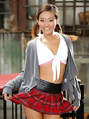 Young Asian pornstar Alina Li posing seductively in schoolgirl uniform