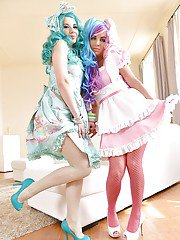 Kinky cosplay chicks Olivia Grace and Onyx Viper removing fishnet stockings