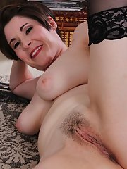 Mature lady Sadie Jones playing with her exposed all natural breasts