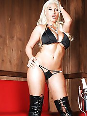 Sexy blond babe Bridgette B striking hot poses in over the knee laced boots