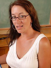 Mature teacher Sandy strips off glasses and skirt to expose vagina