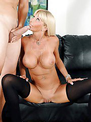 Bosomy blonde cougar Kasey Storm dripping cum from mouth onto big knockers