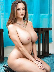 Chesty mom Ava Addams flaunting massive juggs after stripping naked