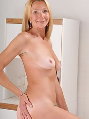 Aged blonde lady Pam Roberts undressing for nude photo shoot