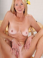 Over 50 blonde MILF Pam Roberts spreading pink labia lips up close