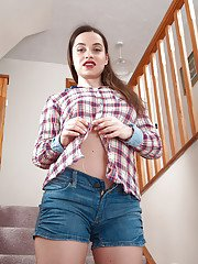 Naughty Euro MILF Olga Cabaeva posing seductively in denim shorts