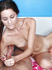 Skinny teenager in pigtails jerks dick and reveals small breasts