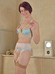Lingerie adorned mature lady Penny Brooks exposing small breasts