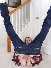 Aged blonde woman Annabelle pulling down jeans to expose pink cunt