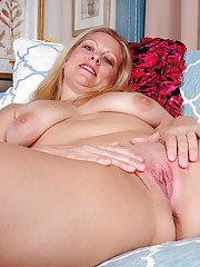 Aged blonde woman Zoey Tyler removing panties to reveal shaved vagina
