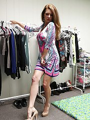 Buxom older lady removes dress and high heels while undressing
