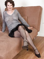 Hairy older dame Artimesia showing off pussy hairs under mesh stockings