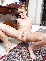 Mature blonde solo model Josie flaunting tiny tits and hairy bush