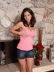 Brunette MILF Angel Little removes shorts and panties to spread bald twat