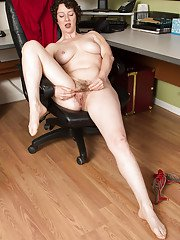 Older secretary Artimesia revealing hairy underarms and pussy in office