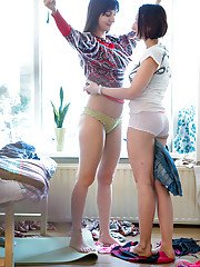 Hidden voyeur films brunette amateurs Alina and Remie pulling on panties