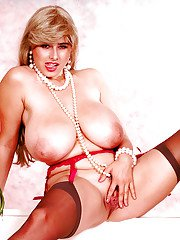 Chesty blonde MILF Chloe Vevrier sporting erect nipples beneath lingerie