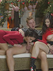 Hot Euro chicks Leanna Sweet and Nekane giving bj in Christmas threesome